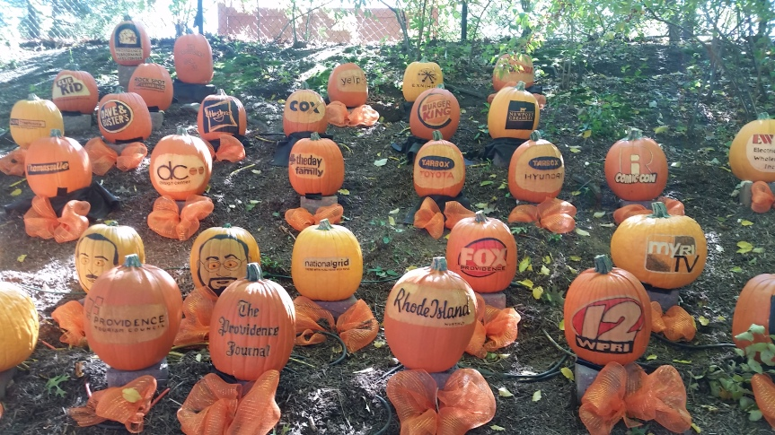 A Genetically Engineered Pumpkin Advertisement, from the Roger Williams Park Zoo in Rhode Island. (Well, they're more of the ordinary painted/carved pumpkins, but it sounds way cooler when you think they might be engineered to produce these writings)